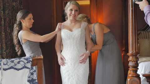 Bride puts on her wedding dress at the Castle Resort in Cavendish, Vermont