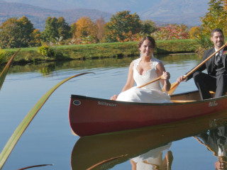 Wedding Couple Pose in Canoe