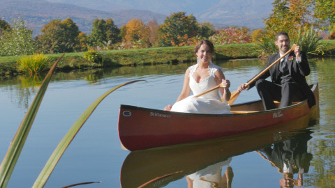 Stowe wedding couple pose in canoe