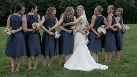 Bride and bridesmaids pose in one of the formals at a wedding at the Mountain Top Inn