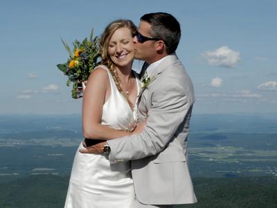 Couple pose on the summit of Jay Peak