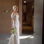 Bride poses in corridor at the Woodstock Inn